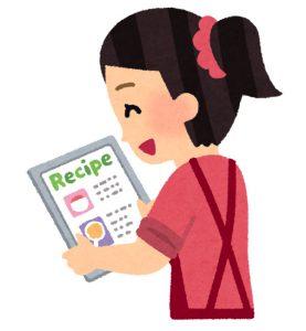 調理方法を見ている女性のイラスト