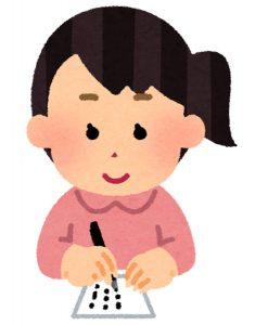 感想のハガキを書いている女性