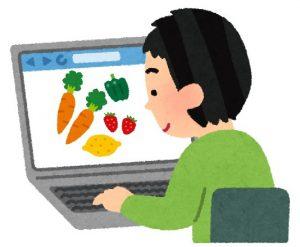 ホームページで有機野菜をチェックするお客様